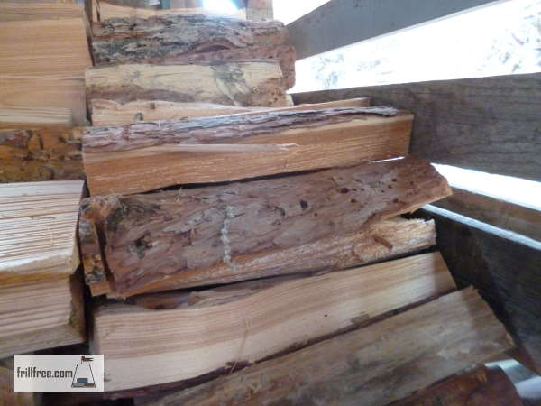 Larch firewood, split and stacked
