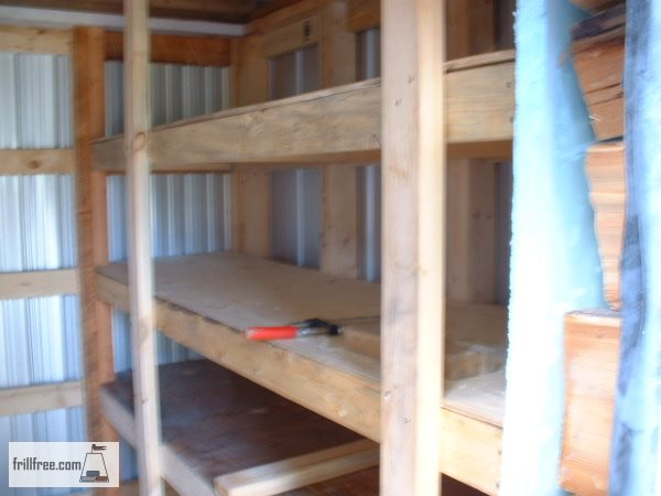 Plywood shelves on 2x4 lumber supports hold up the roof too...