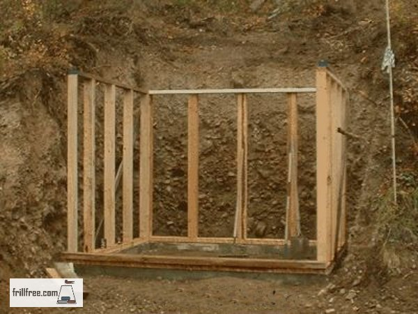 The framework of the earth sheltered root cellar is in place on the footing...