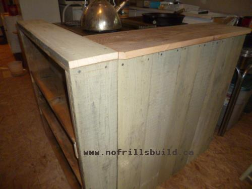 Barnboard (or fence boards, as in this case) make an interesting finish for the peninsula