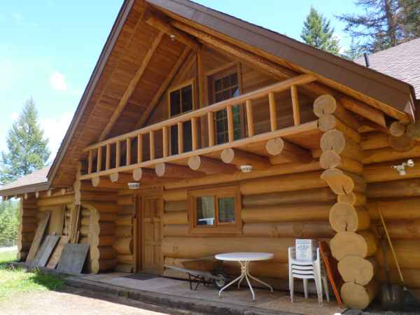 The front door of this great log home is functional and welcoming (if a little sparely furnished!)