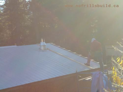 The final piece of metal roofing goes on...