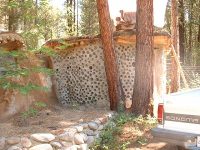 Unique handbuilt buildings, organically transformed out of natural and salvaged building materials