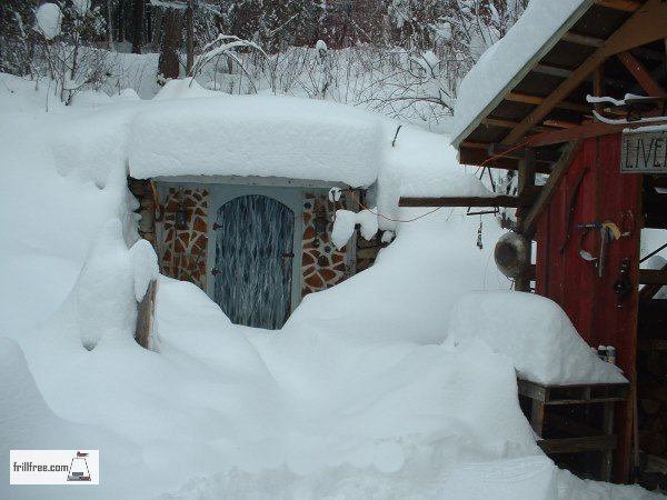Glory Be, the earth sheltered root cellar under a blanket of snow
