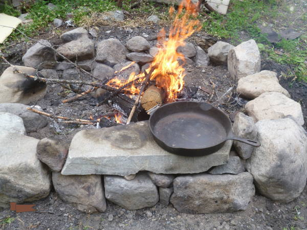 Getting the fire ready for the frying pan