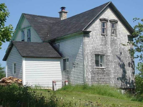 Gothic Revival Farmhouse with shingles