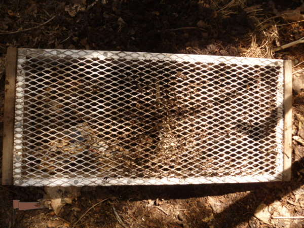 A simple screen for sieving compost
